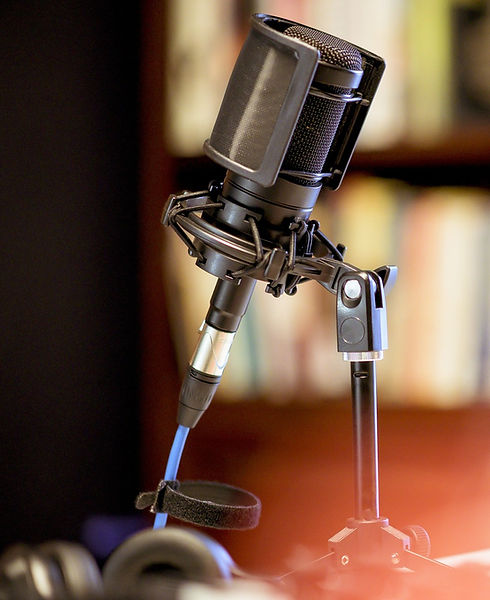 microphone-in-studio-surrounded-by-equipment-under-the-lights-with-blurry-background_edited.jpg
