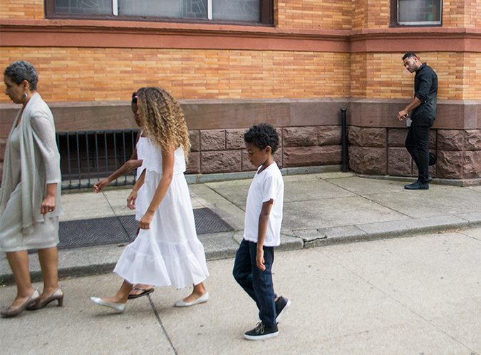 Mama Helen, Simone, Pumpkin & Sharief Leaving the Funeral while Dad looks on.jpg.jpg.jpg.jpgcompelli
