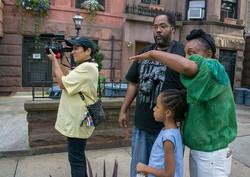 Cuzin & Documentarian  John One-Twenty McFadden, assisting with scene set up