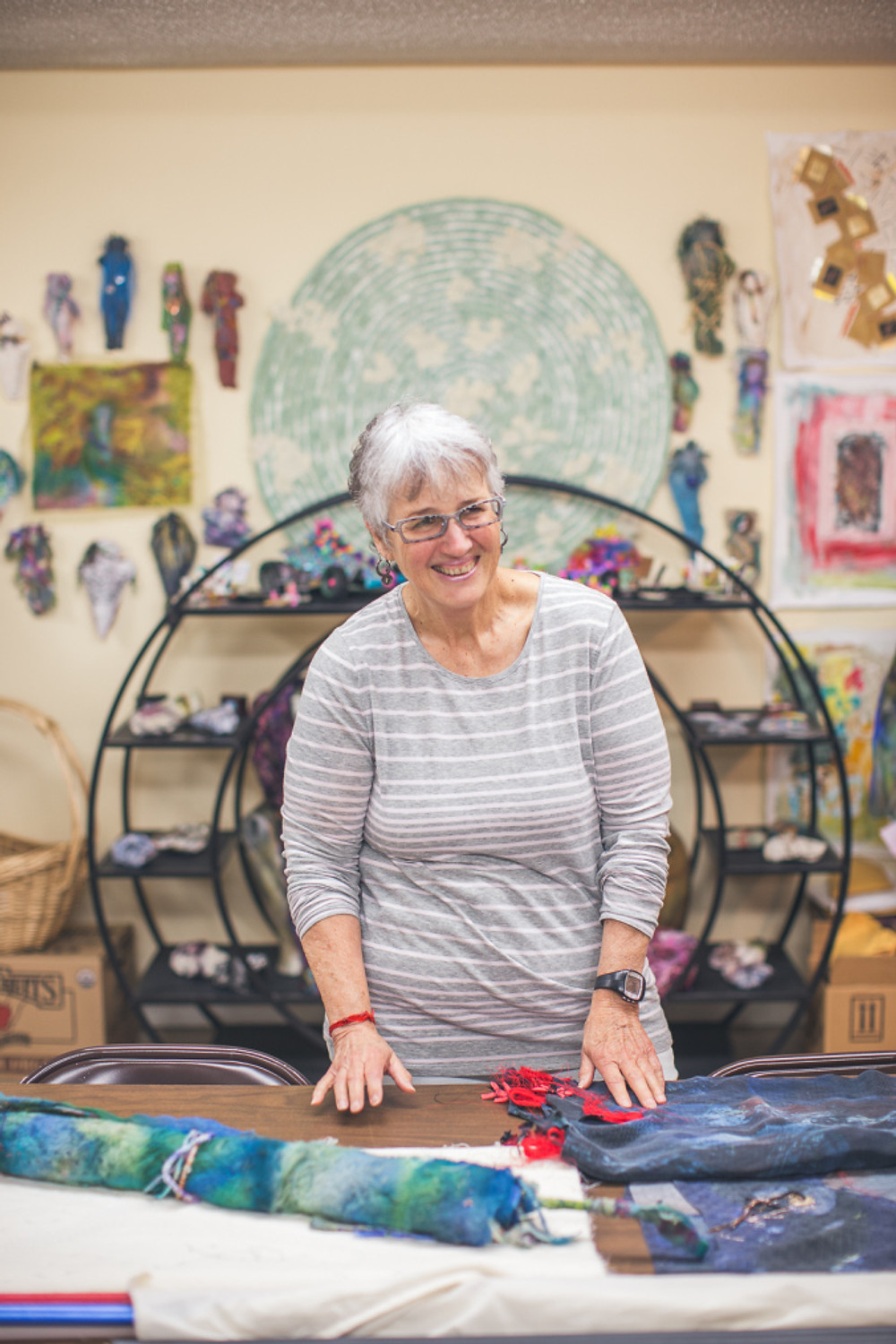 Barbetta Lockart in her studio surrounded by her gorgeous textile art.