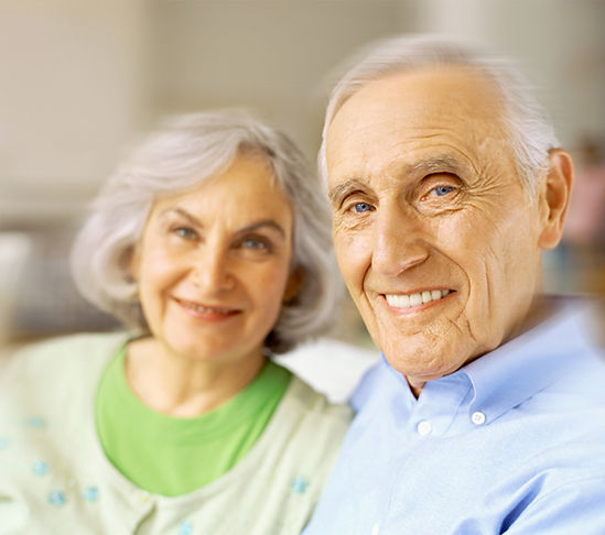 An elderly couple smiling for the camera