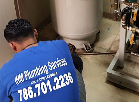 Plumber Fixing Drain
