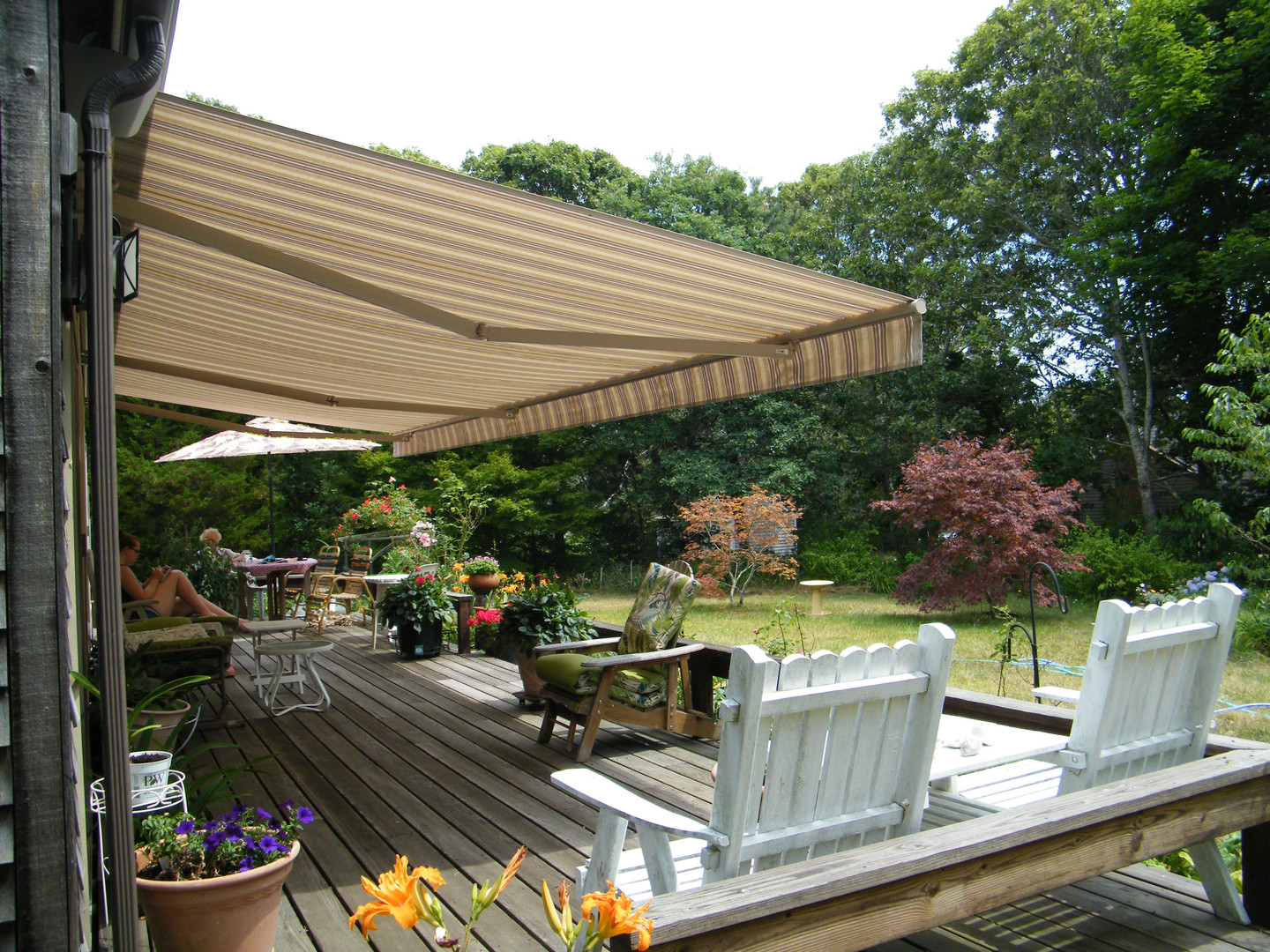 Retractable Tan and White Awning