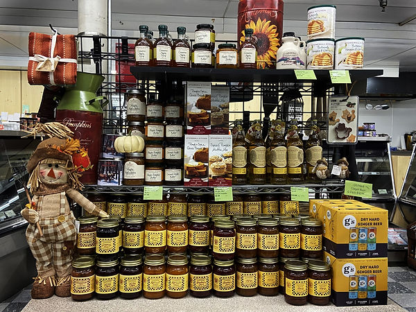 colorful fall display of local jams, syrups, and bread mixes