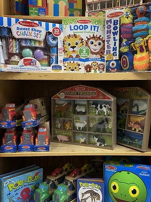shelves of Melissa and Doug Toys.  Balls Puzzles cars