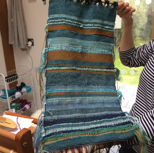 Workshop participant's first weaving