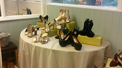 Multiple sets of shoes that we have on display in the charity shop