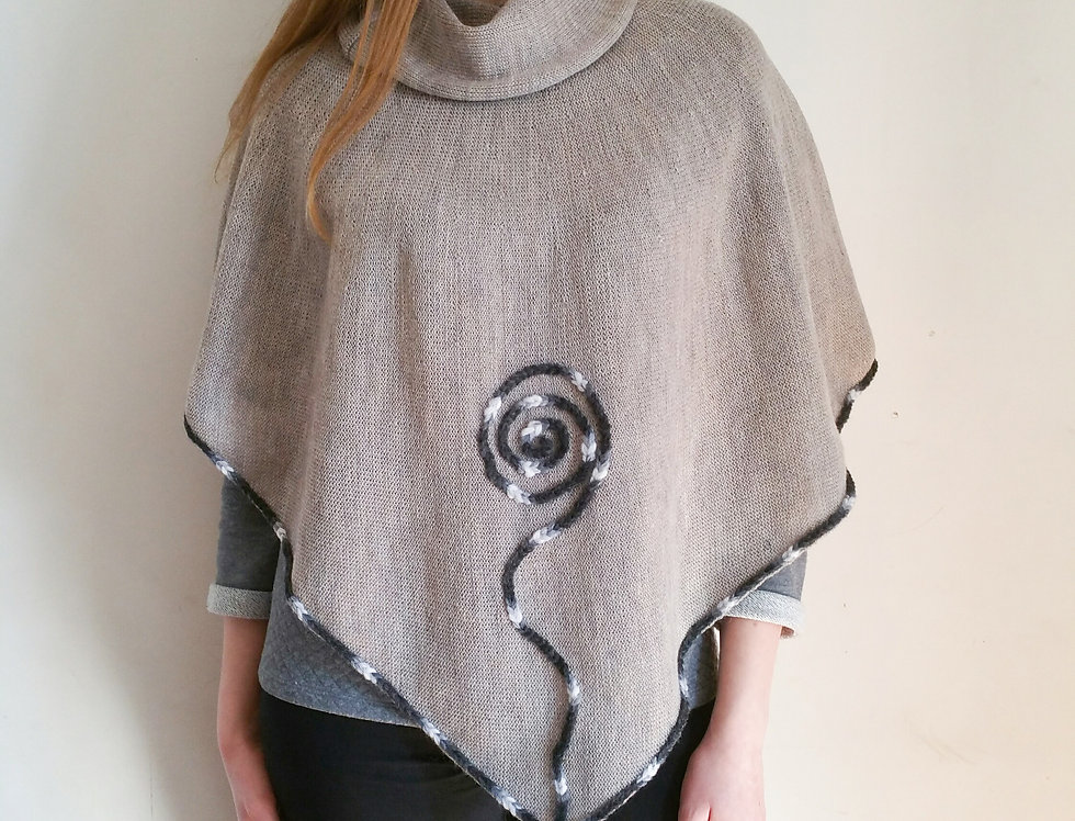 Grey knitted Sprout poncho from front