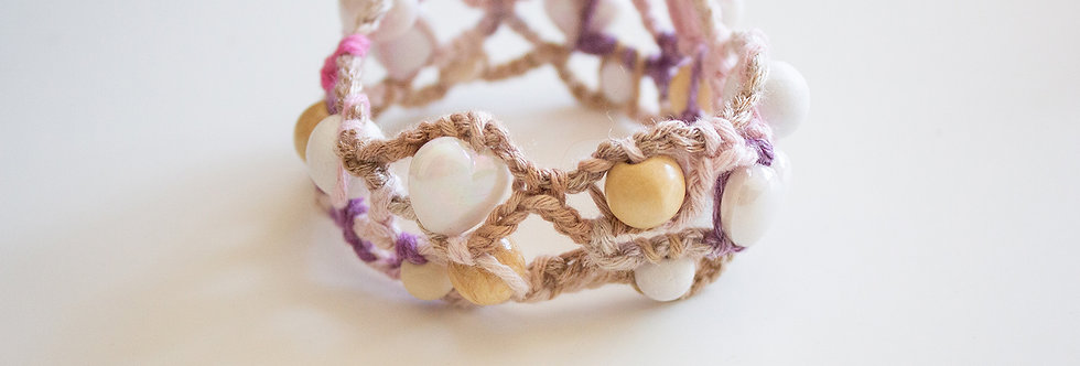 Light pink-wooden crocheted bracelet with wooden pearls