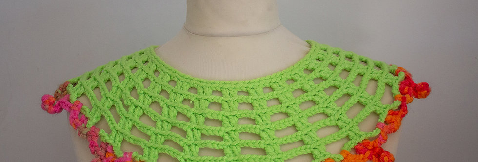 green crocheted lace collar with red crocheted decoration