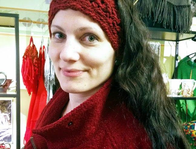 wearing cranberry crocheted headband