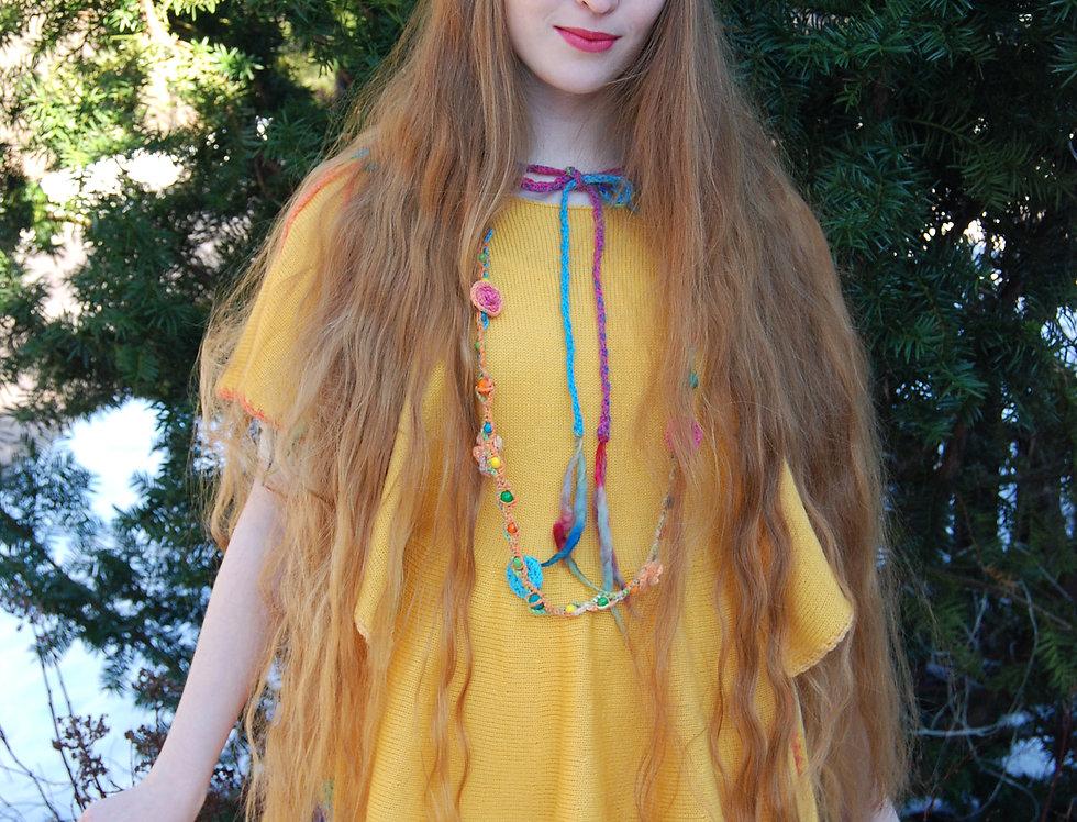 wearing orange knitted fairytale apron outside