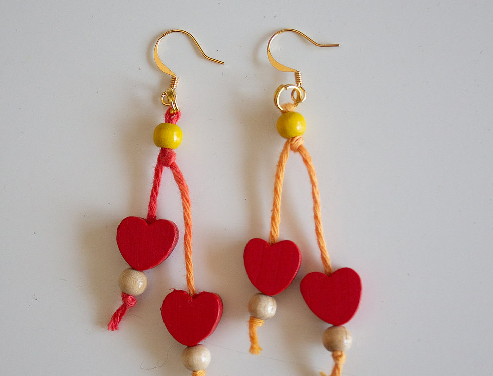 Red earrings with wooden hearts