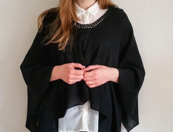 black knitted mother sea poncho front view with sleeves