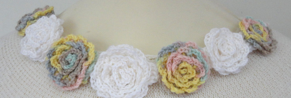White and light yellow crocheted bed of roses tiara