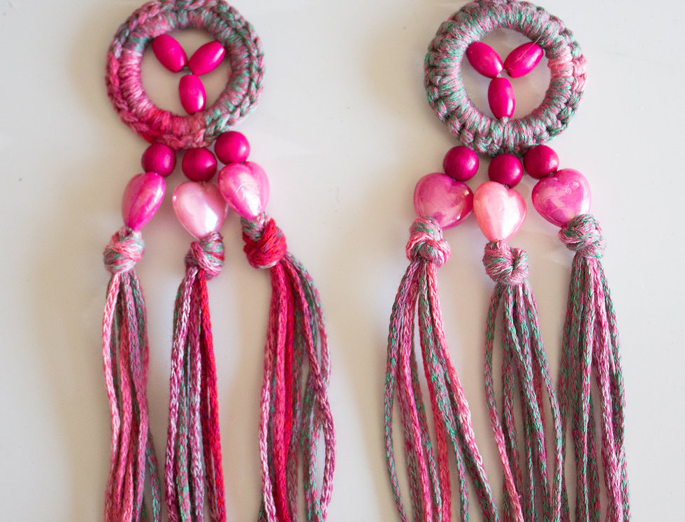 Pink crocheted earrings with wooden pearls