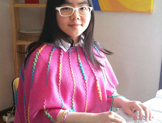 wearing pink knitted ainikki pelerine
