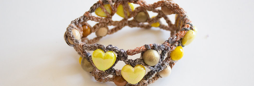 Brown-yellow crocheted bracelet with wooden pearls