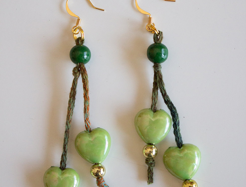 Green earrings with wax pearls