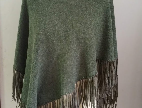 green knitted dervish poncho