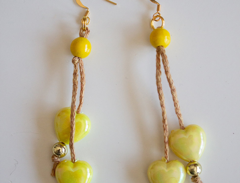 Yellow earrings with wax pearls