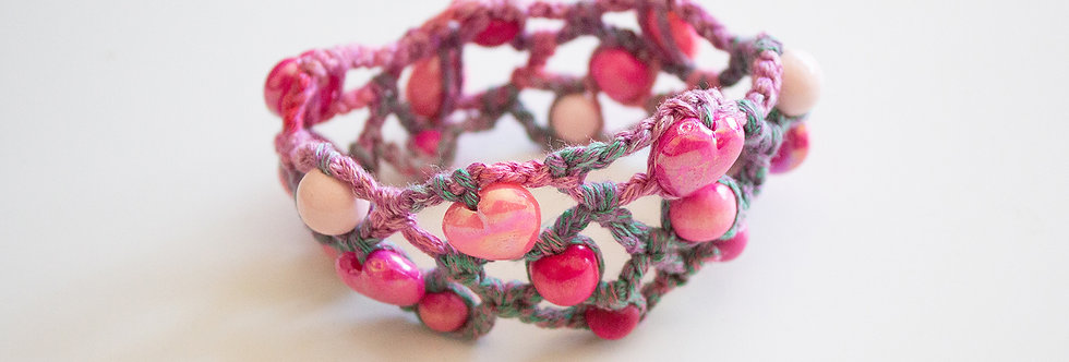 Pink crocheted bracelet with wooden pearls