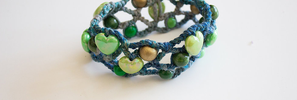 Green crocheted bracelet with wooden pearls