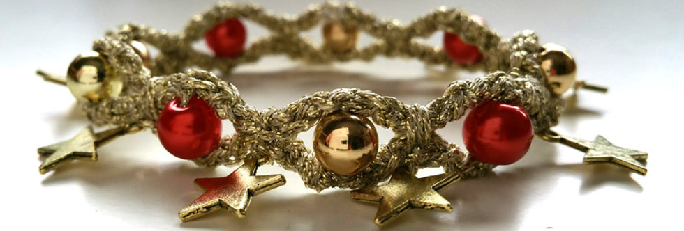 Gold and red coloured crocheted miss nordic starlight bracelet