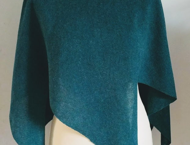petrol green knitted nordic star poncho
