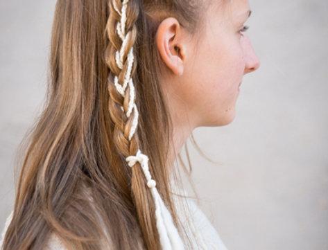 wearing white crocheted dragon braid hair band
