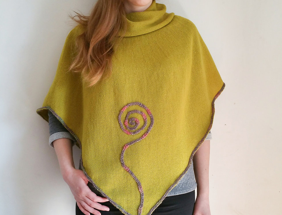 Lime green knitted Sprout poncho from front