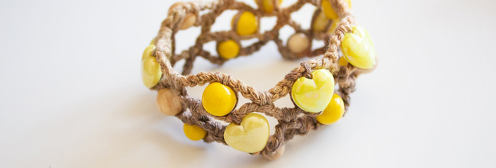 Dark yellow crocheted bracelet with wooden pearls