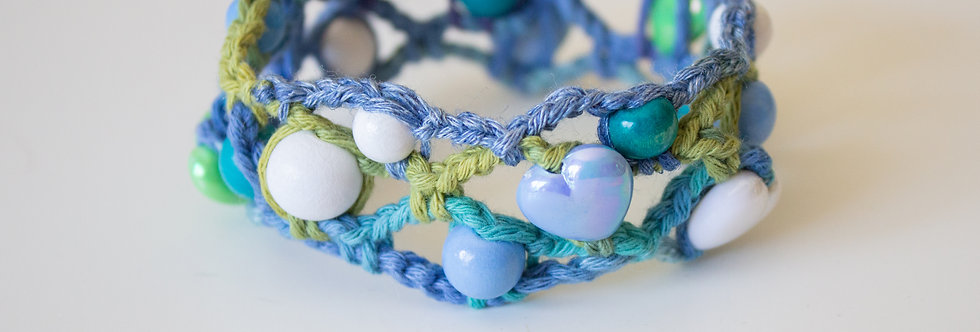 Light blue crocheted bracelet with wooden pearls and wax hearts