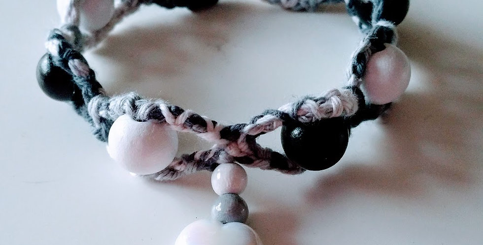 Black and white crocheted bracelet with wooden pearls and wax hearts