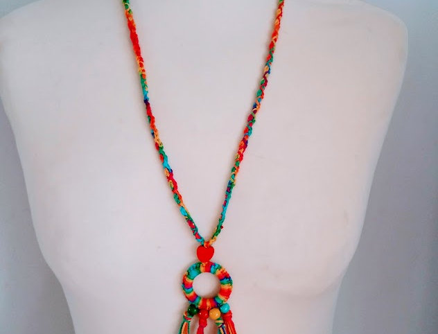 Colourful crocheted pendant with wooden pearls