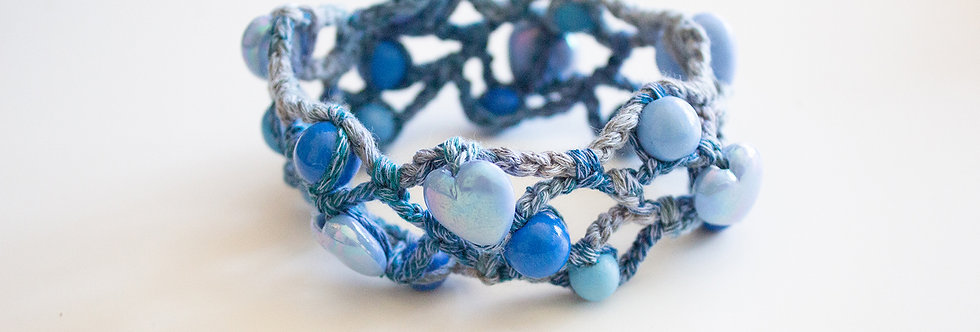 Blue crocheted bracelet with wooden pearls