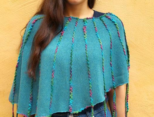 Wearing turquoise knitted ainikki pelerine