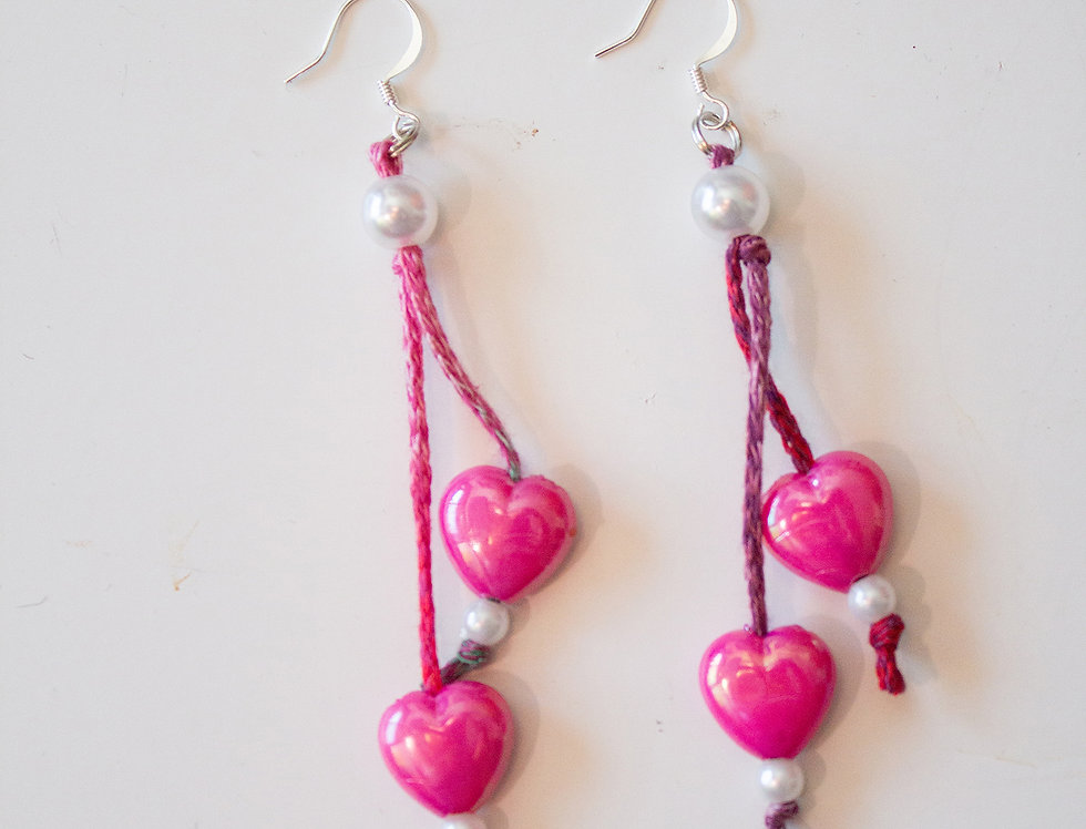 Pink earrings with wax hearts