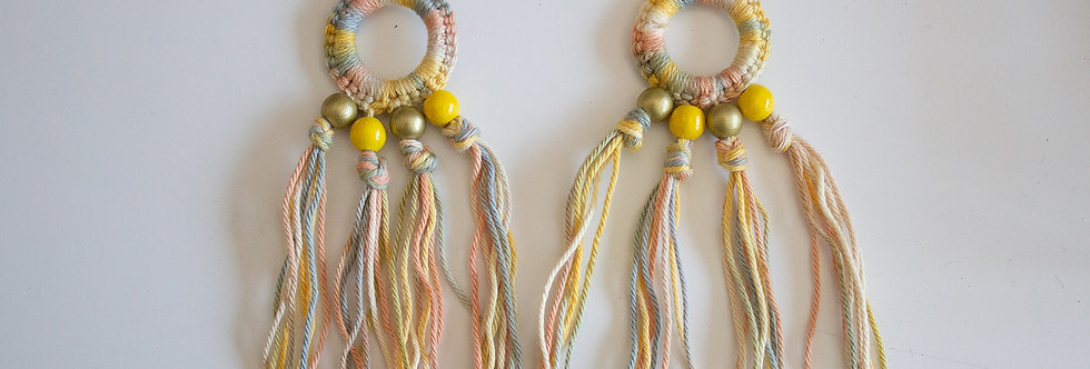 Yellow crocheted earrings with wooden pearls