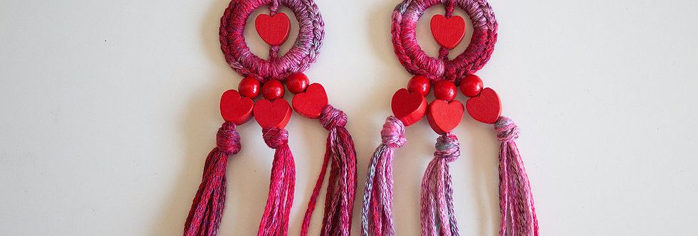Red crocheted earrings with wooden hearts