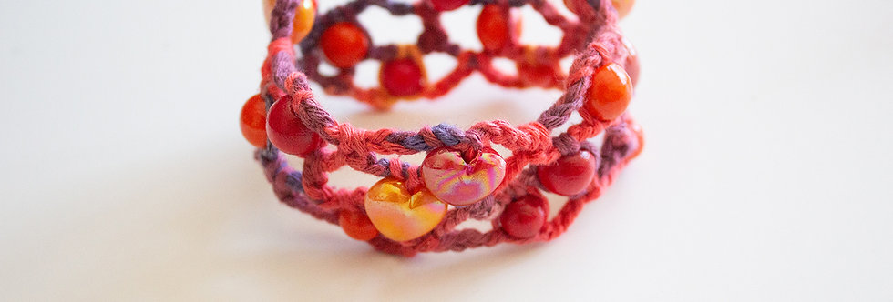 Red-orange crocheted bracelet with wooden pearls