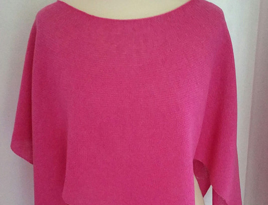pink knitted nordic star poncho