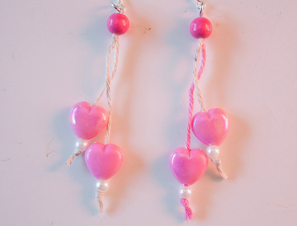 Light pink earrings with wax hearts