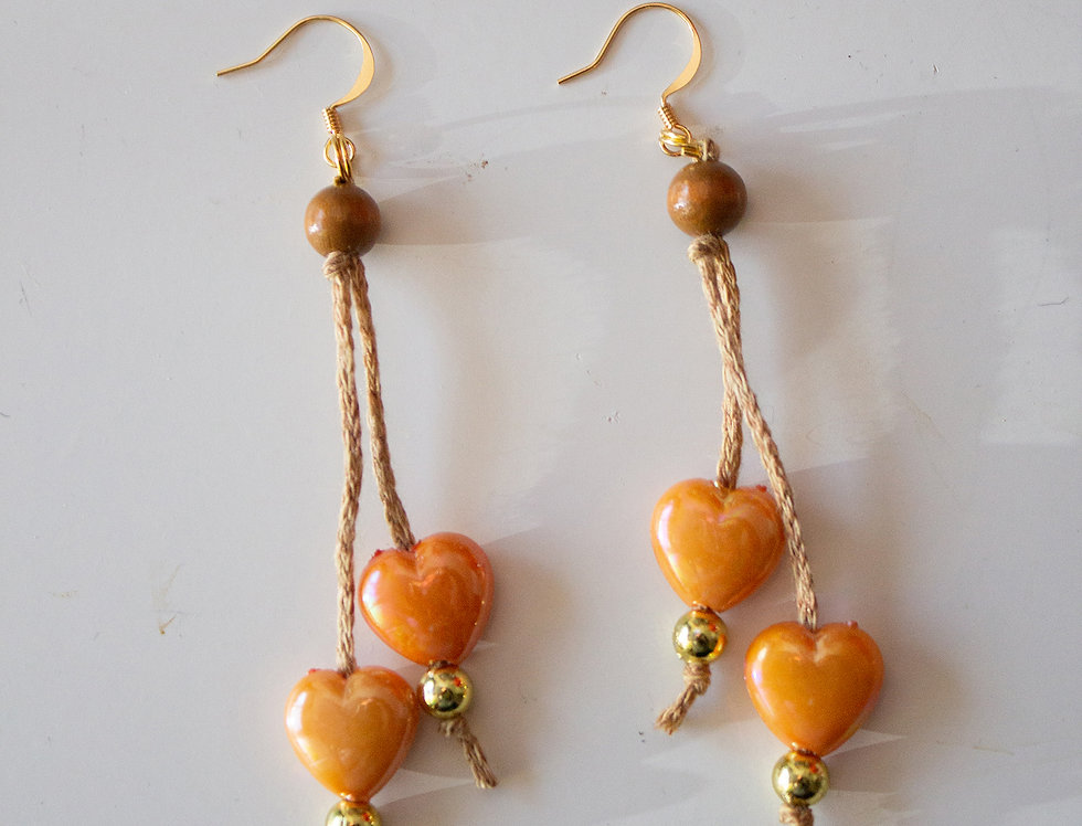 Orange earrings with wax hearts