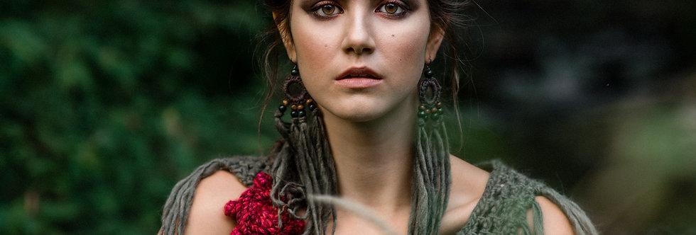 wearing forest green coloured WoodO fringe earrings