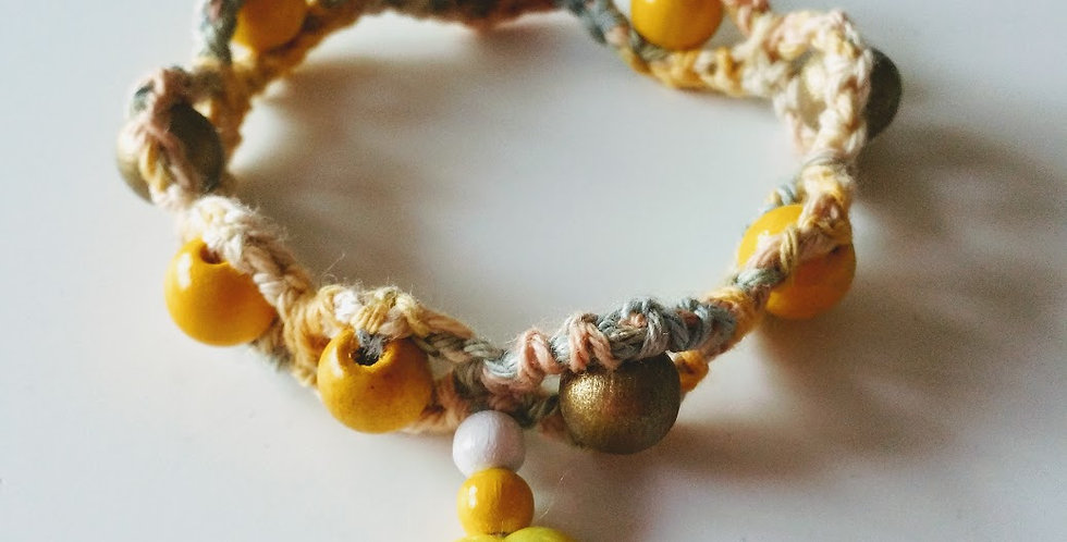 Yellow crocheted bracelet with wooden pearls and wax hearts