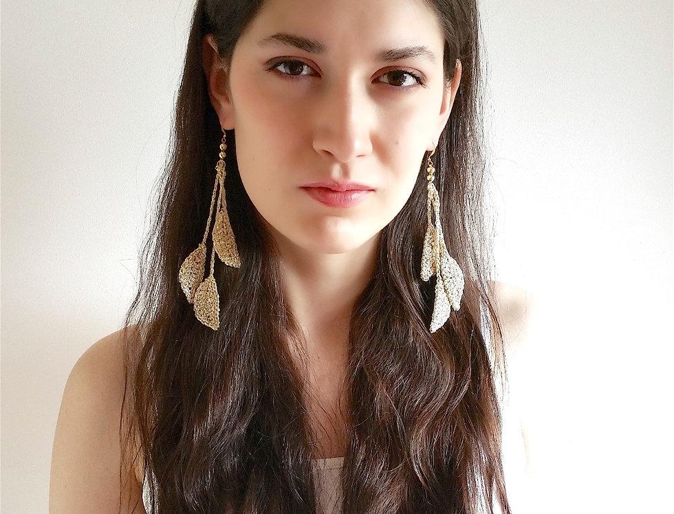 Source earrings, platinum