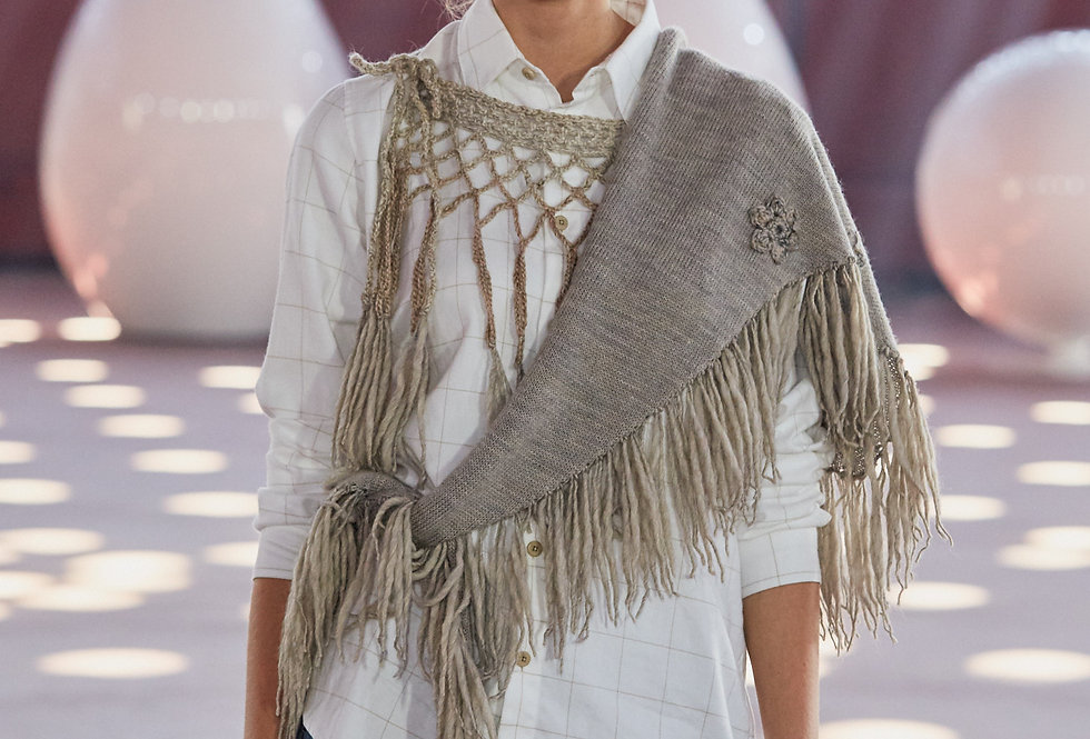Wearing lichen coloured knitted sotka star scarf on catwalk