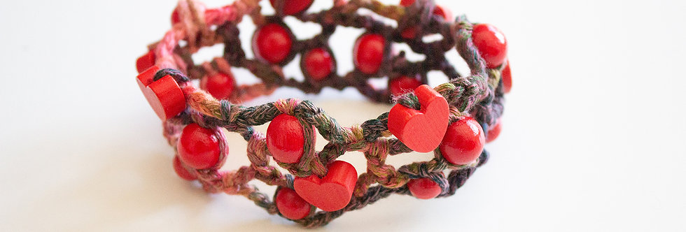 Red crocheted bracelet with wooden pearls