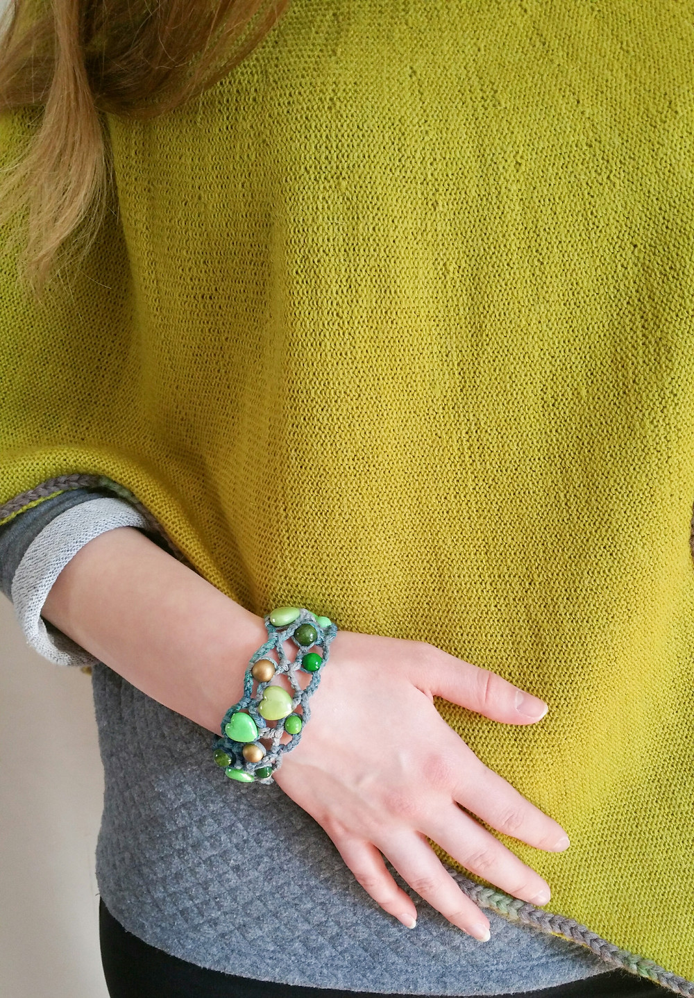 Crocheted green bracelet with knitted green Rune poncho.